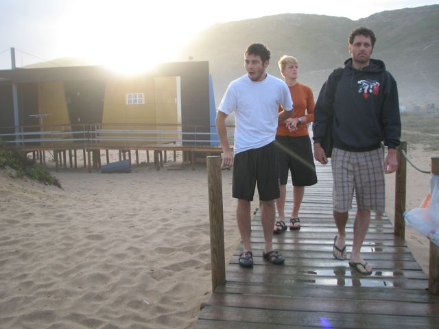 Three groggy campers aproach the beach on Thursday morning to check the surf conditions.  My teammates and roomies from left to right are Andy Gates, Lindsay Usher and Joey Hall.
