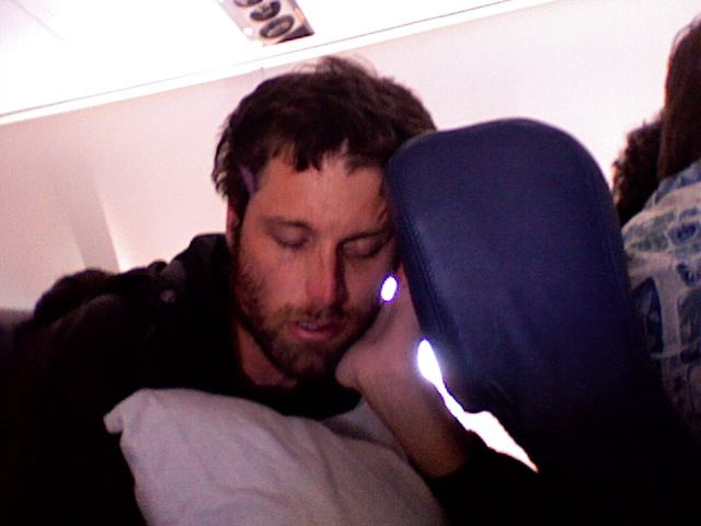 Joey Snoozin on the planeride home.  We caught some Zs off and on during the 9 hour flight home.