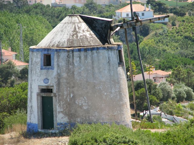 Closer view of an old windmill from the Obidos Castle Walls